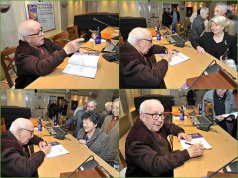 Rafael Contreras firmando su obra